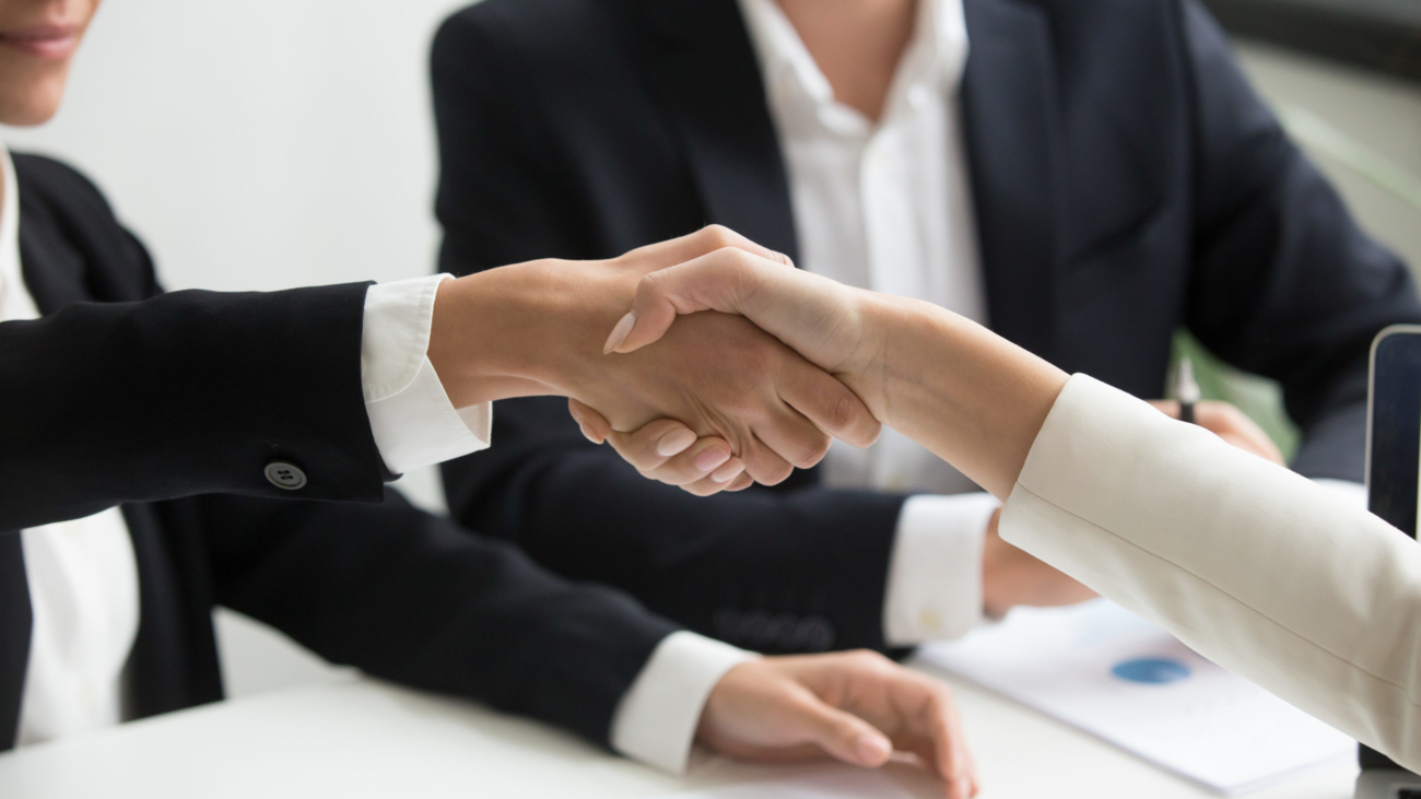 Female hands shaking at group meeting making partnership deal, businesswoman welcoming new partner with handshake as concept of collaboration gratitude respect, women power in business, close up view
